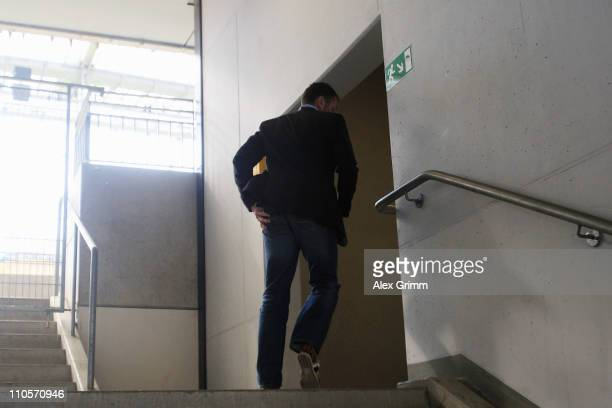 Former head coach Michael Skibbe enters the emergeny exit after a press conference of Eintracht Frankfurt at the Commerzbank Arena on March 22 2011...