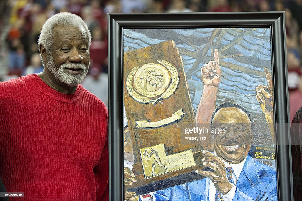 Former Head Coach <a gi-track='captionPersonalityLinkClicked' href=/galleries/search?phrase=Nolan+Richardson&family=editorial&specificpeople=3522868 ng-click='$event.stopPropagation()'>Nolan Richardson</a> of the Arkansas Razorbacks stands beside his painting to commemorate the 75th anniversary of March Madness during a game against the Tennessee Volunteers at Bud Walton Arena on February 2, 2013 in Fayetteville, Arkansas. The Razorbacks defeated the Volunteers 73-60.