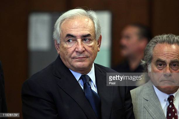 Former head of the International Monetary Fund Dominique StraussKahn appears at an arraignment trial for sexual assault with his lawyer Benjamin...