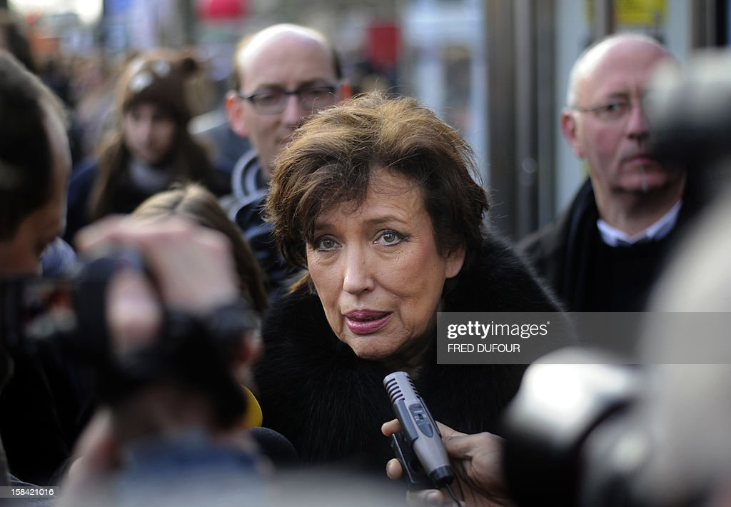 Former Health minister Roselyne Bachelot answers journalists' questions during a demonstration for the legalisation of gay marriage and LGBT (lesbian, gay, bisexual, and transgender) parenting in Paris on December 16, 2012.