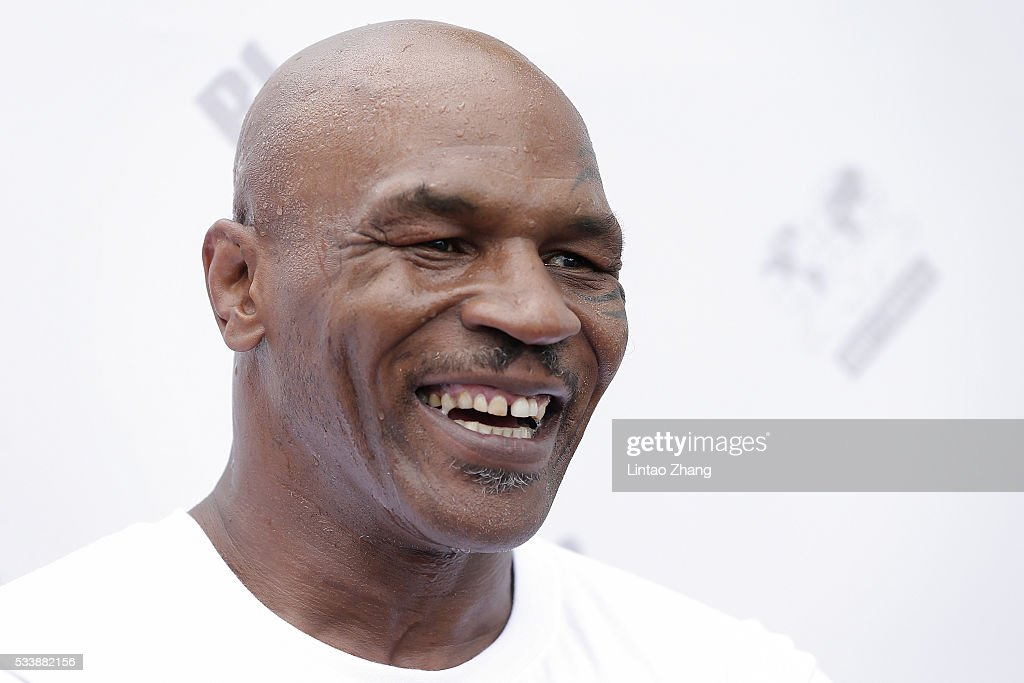 Former Heavy Weight Champion Boxer <a gi-track='captionPersonalityLinkClicked' href=/galleries/search?phrase=Mike+Tyson&family=editorial&specificpeople=194986 ng-click='$event.stopPropagation()'>Mike Tyson</a> attends the Great Wall Weigh-in of IBF World Boxing Championship Bout at Mutianyu on May 24, 2016 in Beijing, China.