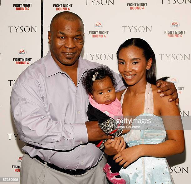 Former Heavy Weight Champion Boxer Mike Tyson with daughter Rayna and youngest daughter attend a screening of 'Tyson' at the AMC Loews 19th Street on...