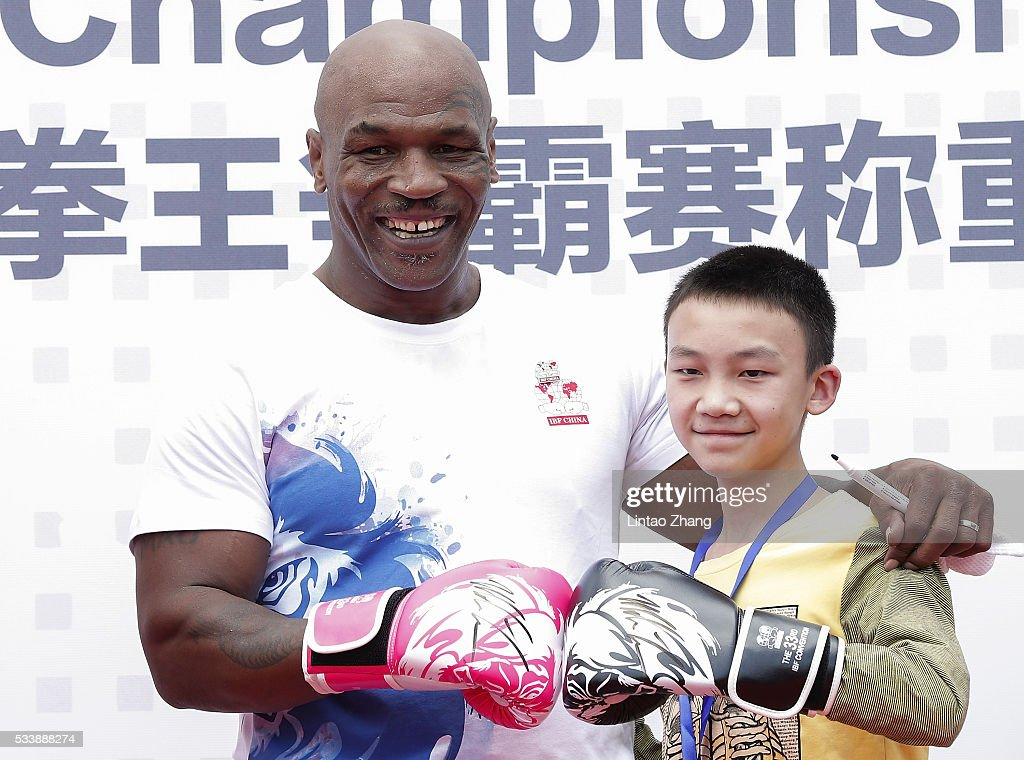 Former Heavy Weight Champion Boxer <a gi-track='captionPersonalityLinkClicked' href=/galleries/search?phrase=Mike+Tyson&family=editorial&specificpeople=194986 ng-click='$event.stopPropagation()'>Mike Tyson</a> with young fans attends the Great Wall Weigh-in of IBF World Boxing Championship Bout at Mutianyu on May 24, 2016 in Beijing, China.