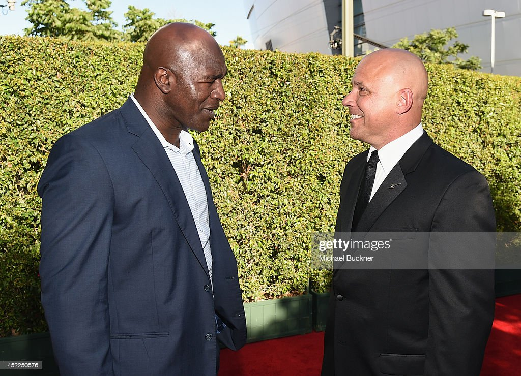 Former Heavyweight boxer Evander Holyfield and former MLB player Jim Leyritz (R) attend The 2014 ESPYS at Nokia Theatre L.A. Live on July 16, 2014 in Los Angeles, California.