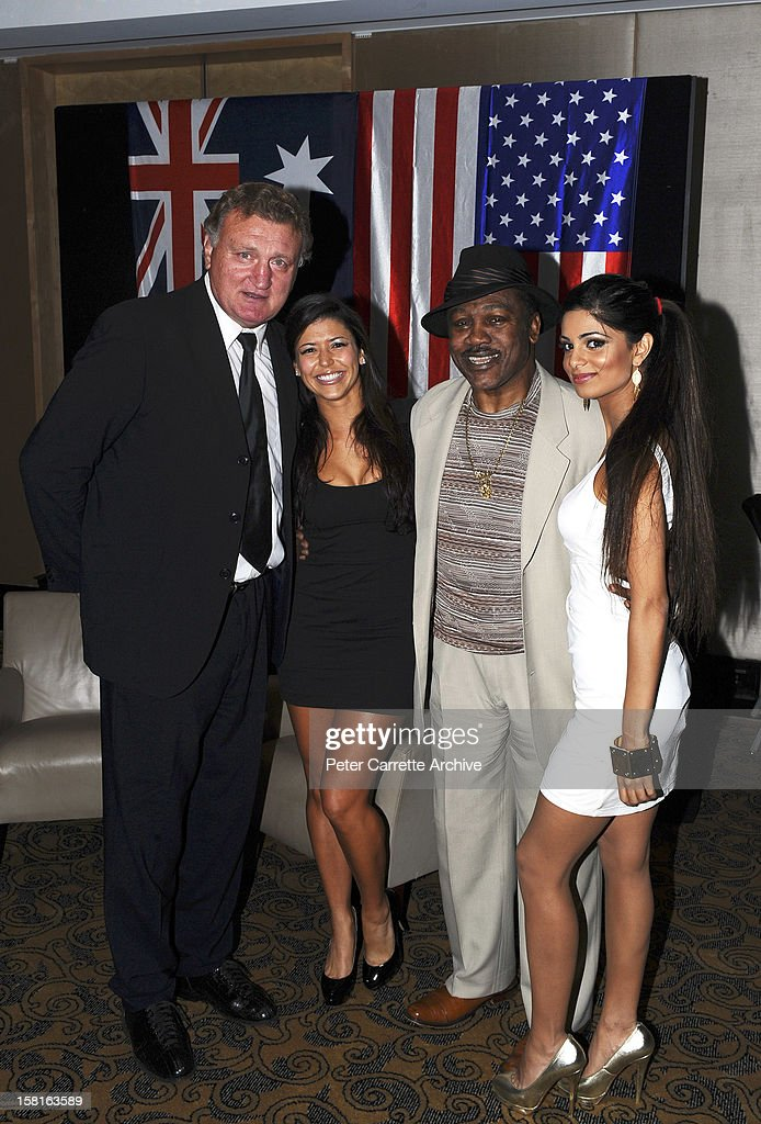 Former heavyweight boxers <a gi-track='captionPersonalityLinkClicked' href=/galleries/search?phrase=Joe+Bugner&family=editorial&specificpeople=239003 ng-click='$event.stopPropagation()'>Joe Bugner</a> (L) and <a gi-track='captionPersonalityLinkClicked' href=/galleries/search?phrase=Joe+Frazier+-+Boxer&family=editorial&specificpeople=214108 ng-click='$event.stopPropagation()'>Joe Frazier</a> (2nd R) pose with models at a tribute and testimonial dinner to celebrate Bugner's 60th birthday at the Sofitel Hotel on March 12, 2010 in Sydney, Australia.