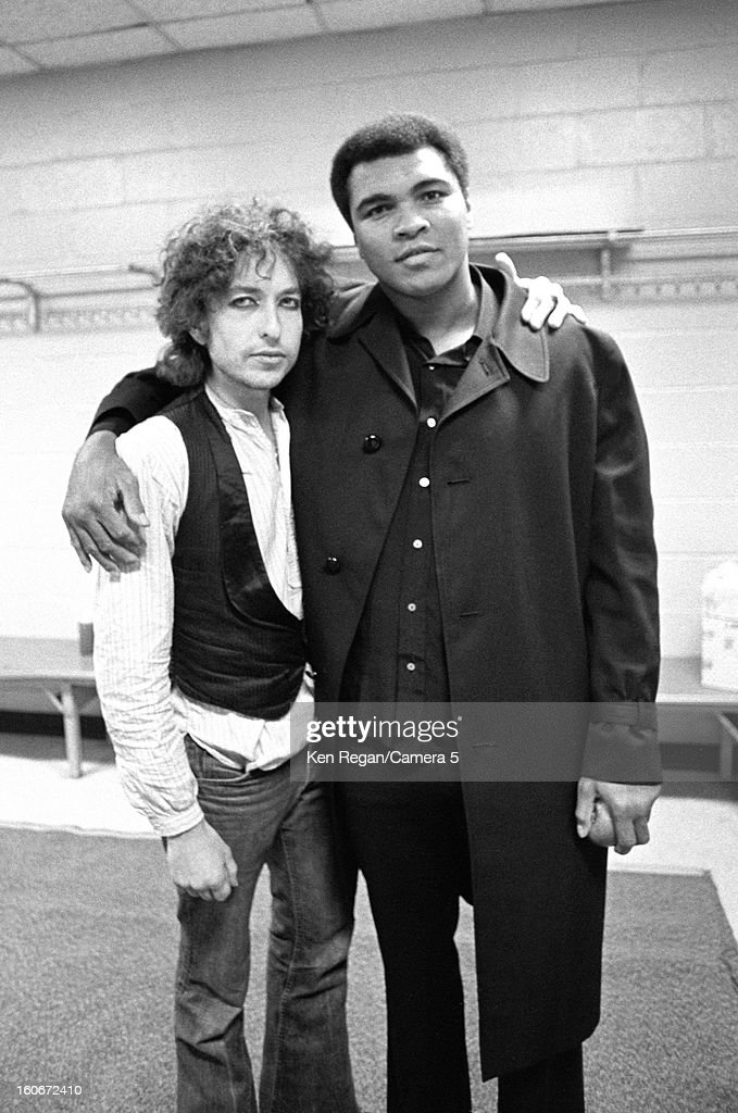 Former heavyweight boxing champion Muhammad Ali and musician Bob Dylan are photographed backstage in Madison Square Garden on December 8, 1975 in New York City.