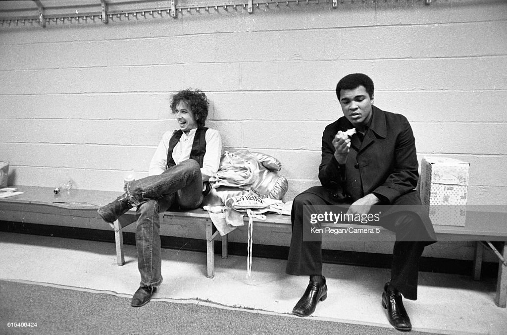 Former heavyweight boxing champion Muhammad Ali and musician Bob Dylan are photographed backstage after 'Night of the Hurricane' final night of Rolling Thunder Revue Tour in Madison Square Garden on December 8, 1975 in New York City.