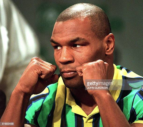 Former heavyweight champion Mike Tyson clenches his fists during a 25 June press conference at the MGM Grand Hotel in Las Vegas NV Tyson will fight...