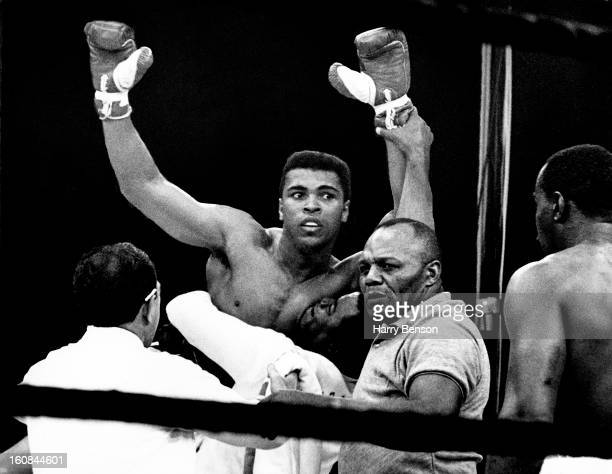 Former heavyweight champion Muhammad Ali is photographed after defeating Sonny Liston in 1965 in Lewiston Maine Referee Jersey Joe Walcott is looking...