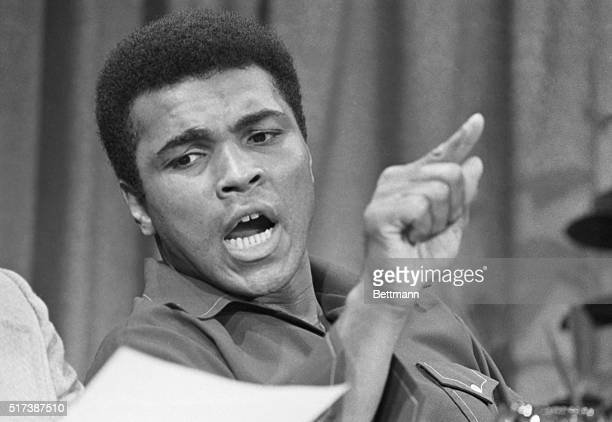 Former heavyweight champion Muhammed Ali stresses a point during a press conference at which it was announced that he would fight two 5round...
