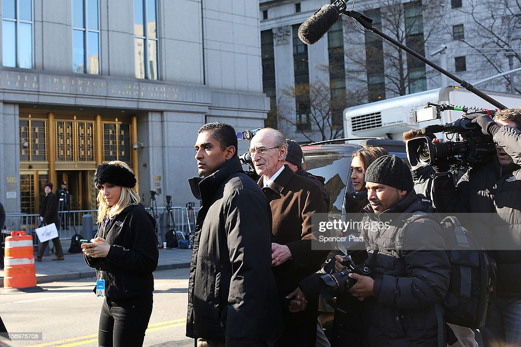 Former hedge fund portfolio manager Mathew Martoma (2L) exits a New York federal court after being charged in one of the biggest insider trading cases in history on November 26, 2012 in New York City. Martoma, who was arrested at his home in Boca Raton, Florida, worked for CR Intrinsic Investors LLC between 2006 and 2008. He was released on $5 million bail after being charged with using insider information to make more than $276 million for his fund and others.