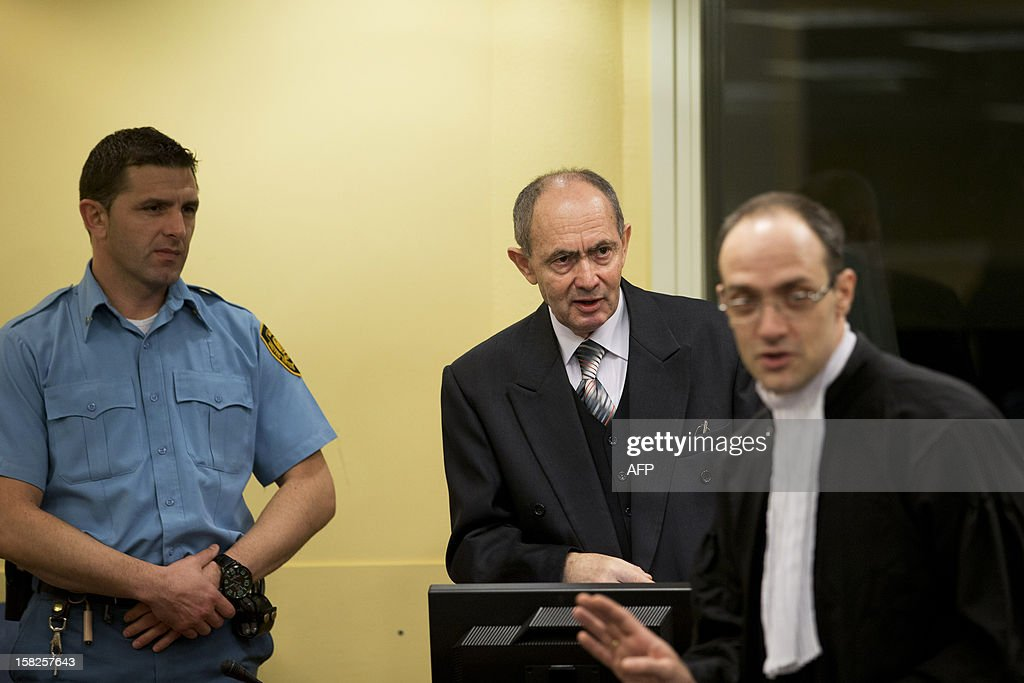 Former high-ranking Bosnian Serb general Zdravko Tolimir (C), waits for the the Yugoslav war crimes tribunal to deliver its judgement and sentence for genocide charges for his role in the 1995 Srebrenica massacre in The Hague on December 12, 2012. German judge Christoph Flugge is to read his judgement and sentencing before the International Criminal Tribunal for the former Yugoslavia shortly after the hearing starts at 3:00 pm (1400 GMT) before the Hague-based tribunal with the Prosecutors asking a life sentence. AFP PHOTO / ANP / PETER DEJONG netherlands out