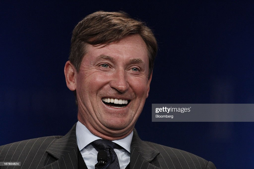 Former hockey player Wayne Gretzky laughs during the annual Milken Institute Global Conference in Beverly Hills, California, U.S., on Monday, May 1, 2013. The conference brings together hundreds of chief executive officers, senior government officials and leading figures in the global capital markets for discussions on social, political and economic challenges. Photographer: Jonathan Alcorn/Bloomberg via Getty Images