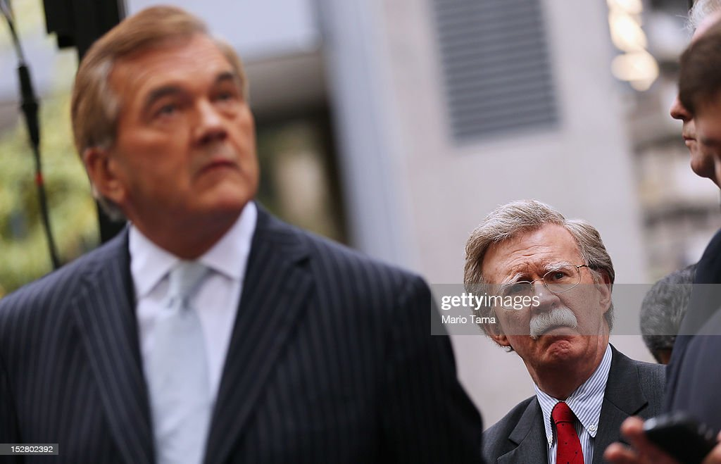 Former Homeland Security Secretary <a gi-track='captionPersonalityLinkClicked' href=/galleries/search?phrase=Tom+Ridge&family=editorial&specificpeople=138617 ng-click='$event.stopPropagation()'>Tom Ridge</a> (L) and former U.N. Ambassador John Bolton attend a rally of groups opposing Iranian President Ahmadinejad's speech at the United Nations General Assembly on September 26, 2012 in New York City. Politicians including former New York Mayor Rudolph Giuliani, former House Speaker Newt Gingrich and former New Mexico Governor Bill Richardson also spoke at the pro-democracy rally which also included Syrian pro-democracy protesters.