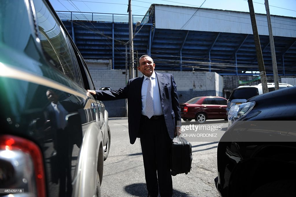 Former Honduran president and deputy of the Central American Parliament (Parlacen) Porfirio Lobo leaves the Parlacen building after a meeting, in Guatemala City on January 28, 2015. AFP PHOTO Johan Ordonez