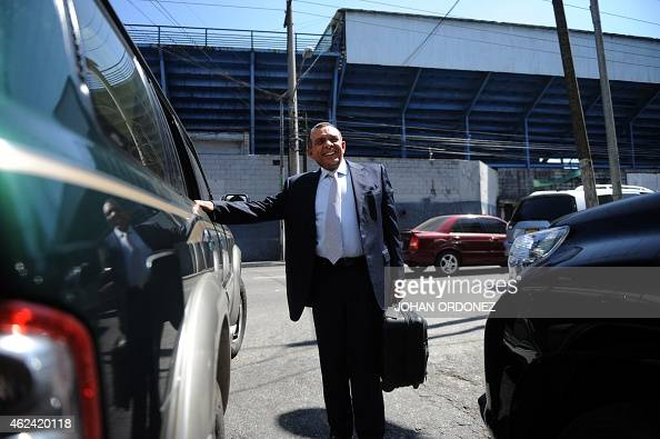 Former Honduran president and deputy of the Central American Parliament Porfirio Lobo leaves the Parlacen building after a meeting in Guatemala City...