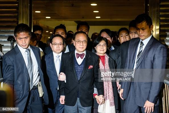 TOPSHOT Former Hong Kong chief executive Donald Tsang reacts as he and his wife Selina leave the High Court after the jury found him guilty of...