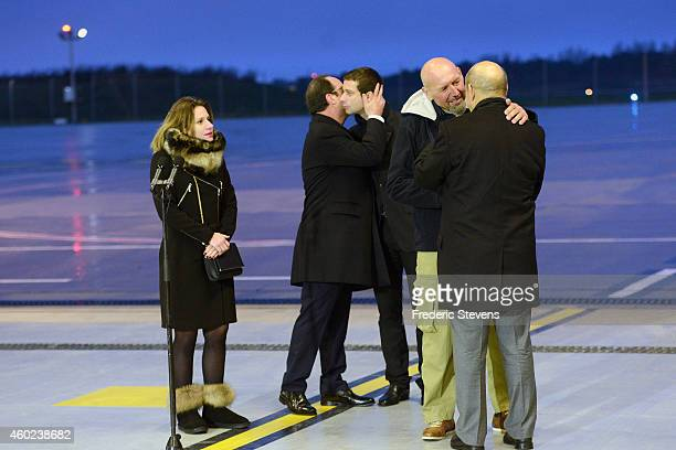 Former hostage Serge Lazarevic is welcomed by French Defence Minister JeanYves Le Drian as French President Francois Hollande embraces Clement Verdon...