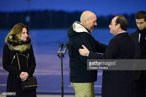 Former hostage Serge Lazarevic is welcomed by French President Francois Hollande as his daughter Diane and Clement Verdon son of French executed...
