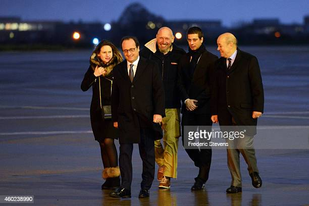 Former hostage Serge Lazarevic is welcomed by French President Francois Hollande his daughter Diane Clement Verdon son of French executed hostage...
