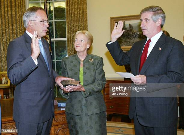 Former House Intelligence Committee Chairman Rep Porter Goss is sworn in as the Director of CIA by White House Chief of Staff Andrew Card in the Oval...