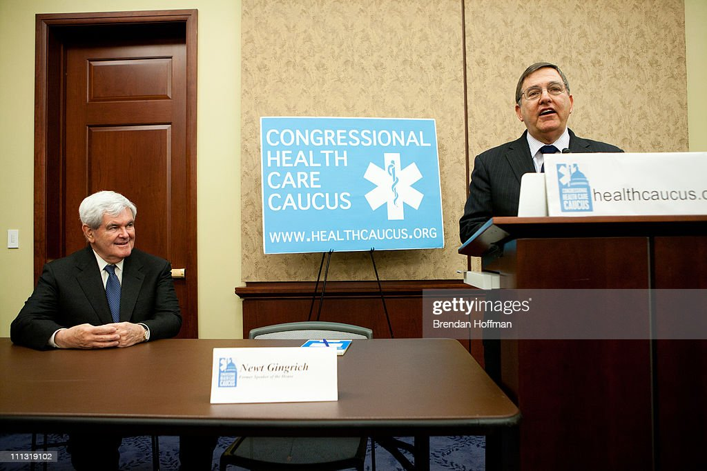 Former House Speaker Newt Gingrich is introduced by Rep Michael C Burgess at an event on health care in the US Capitol on March 31 2011 in Washington...