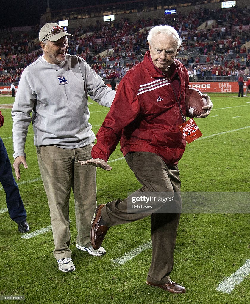 Former Houston Cougars head football coach Bill Yeomann gives the 'Heisman' pose as he receives the football for the final touchdown against the Tulane Green Wave at Robertson Stadium on November 24, 2012 in Houston, Texas. Houston defeats Tulane 40-17.