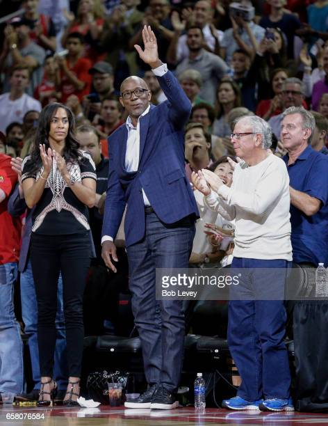 Former Houston Rocket Clyde Drexler acknowledges the crowd after he was introduced as part of the Houston Rockets 50th Anniversary as Rockets ower...
