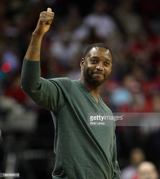 Former Houston Rocket Tracy McGrady acknowledges the crowd during a game between the Charlotte Bobcats and Houston Rockets at Toyota Center on...