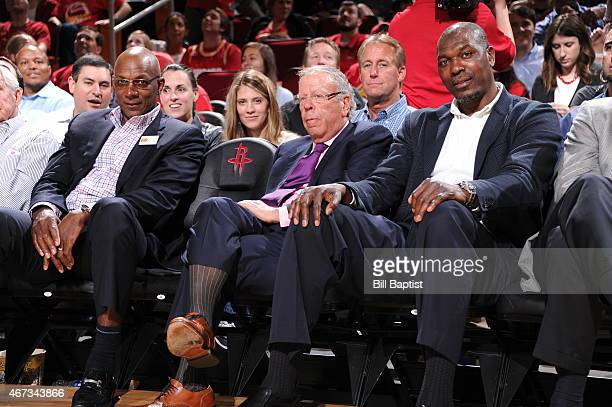 Former Houston Rockets Clyde Drexler Leslie Alexander and Hakeem Olajuwon attend the Denver Nuggets game against the Houston Rockets on March 19 2015...