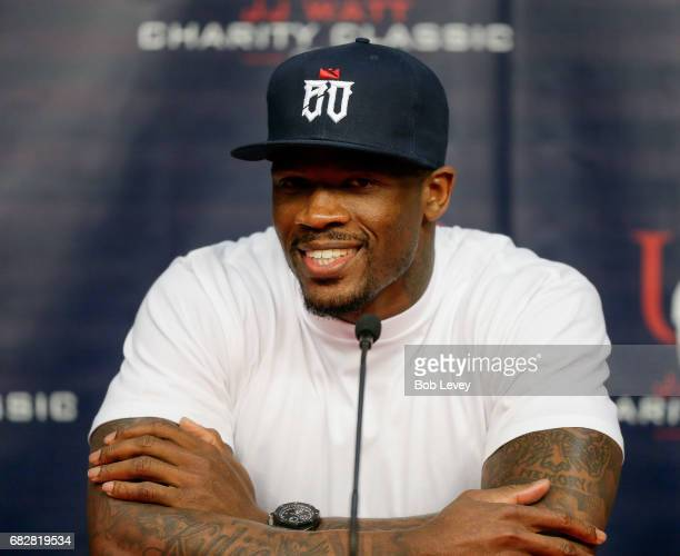 Former Houston Texans wide receiver Andre Johnson speaks to the media about his participation in the JJ Watt Charity Softball Game at Minute Maid...