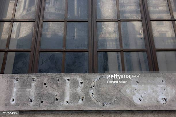A former HSBC Bank name and logo on the side of a closed branch in the City of London The closed branch of this bank has left the faint trace of...