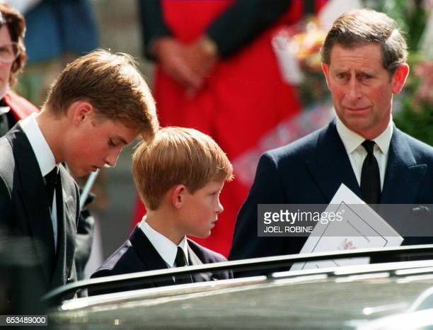 Former husband of Diana Prince Charles and their two sons Harry and William wait in front of the Westminster Abbey in London after the funeral...