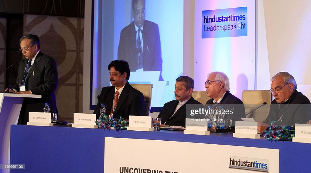 Former IAS Dhanendra Kumar speaking as Chief minister of Haryana Bhupinder Singh Hooda along with other panelist sitting on dias Naresh Trehan, Former CEC India SY Quraishi , Resident Editor Ramesh Vinayak during panel discussion on uncovering the Haryana growth story Gains, Gaps and Goals at Leaderspeak@ht, on February 8, 2013 in Gurgaon, India.