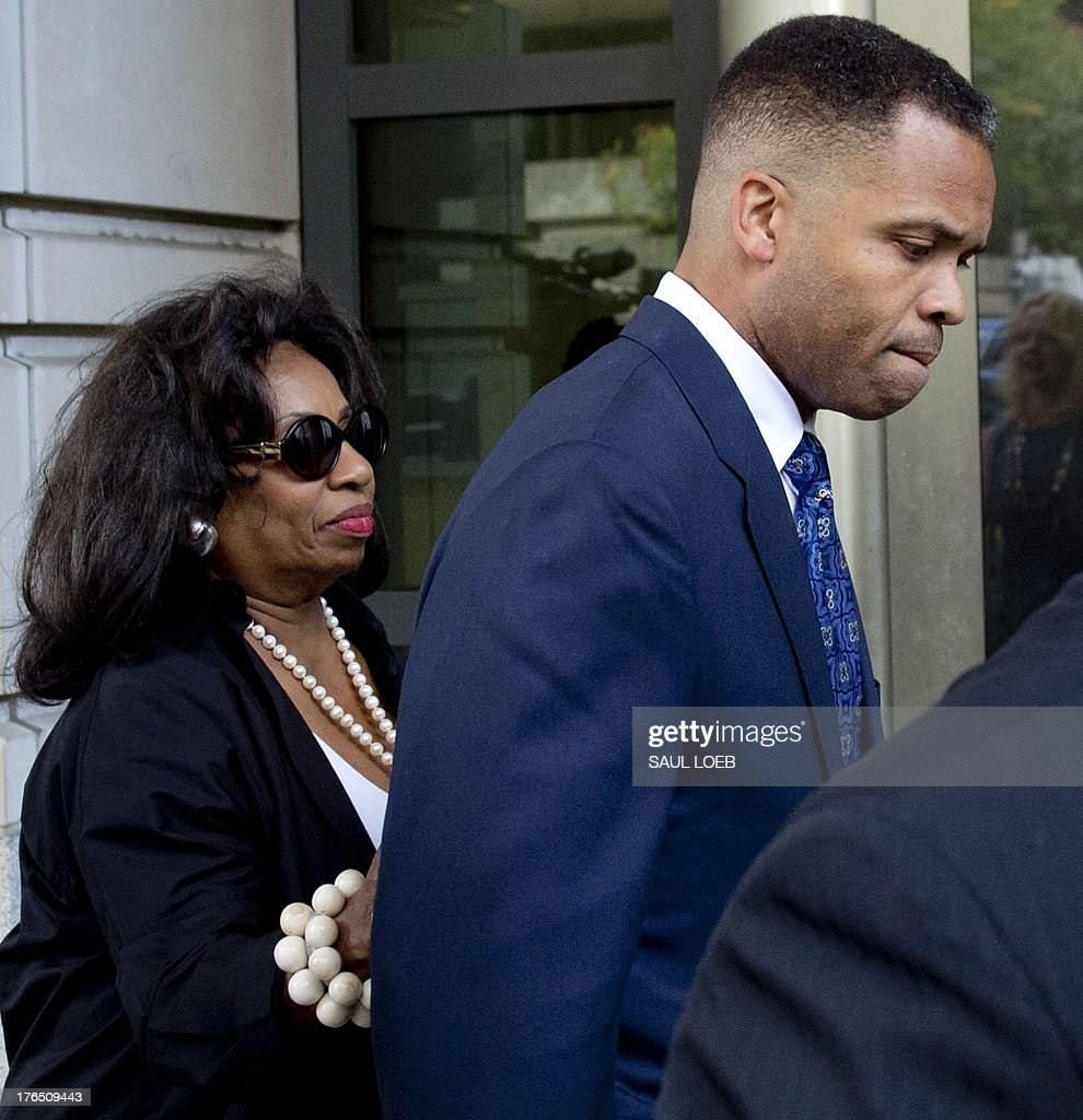 Former Illinois Congressman Jesse Jackson Jr., walks with his mother, Jacqueline lavinia Brown, as he leaves the US District Court in Washington, DC, August 14, 2013, following a sentencing hearing. Jackson was sentenced today to 30 months behind bars and his wife, Sandi, got a year in prison for separate felonies involving the misspending of about $750,000 in campaign funds. The Jacksons will be allowed to serve their sentences one at a time, with Jackson Jr. going first. In addition to the 2.5 years in prison, Jackson Jr. was sentenced to three years of supervised release. Sandi Jackson was ordered to serve 12 months of supervised release following her prison term. AFP PHOTO / Saul LOEB