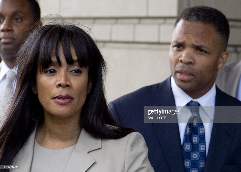 Former Illinois Congressman Jesse Jackson Jr walks with his wife Sandi Jackson as they leave the US District Court in Washington DC August 14...