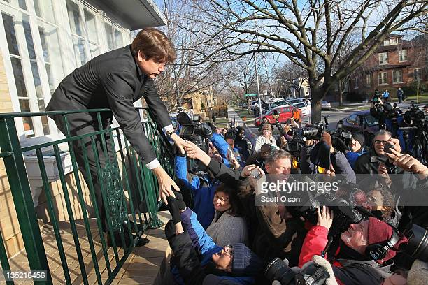 Former Illinois Governor Rod Blagojevich greets supporters outside his home after returning from his sentencing hearing December 7 2011 in Chicago...