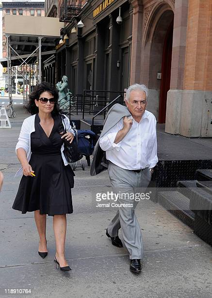Former IMF Chief Dominique StraussKahn accompanied by his wife Anne Sinclair arrive at their temporary residence on July 12 2011 in the Tribeca...