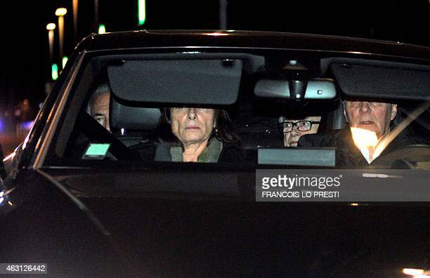 Former IMF chief Dominique StraussKahn and his lawyer Henri Leclerc ride in a car as they leave the Lille courthouse northern France on February 10...