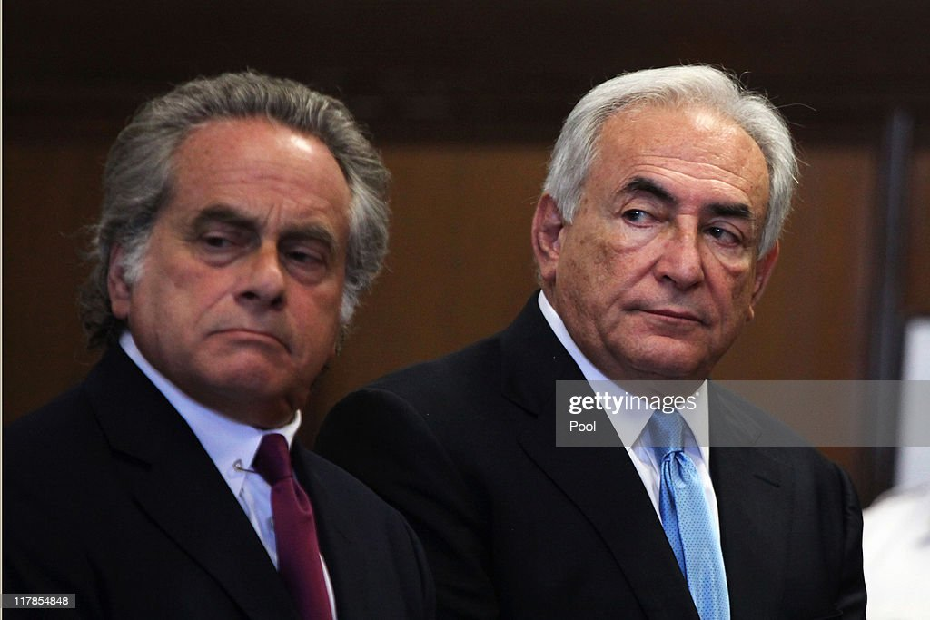 Former IMF Chief <a gi-track='captionPersonalityLinkClicked' href=/galleries/search?phrase=Dominique+Strauss-Kahn&family=editorial&specificpeople=227268 ng-click='$event.stopPropagation()'>Dominique Strauss-Kahn</a> (R) stands with his lawyer <a gi-track='captionPersonalityLinkClicked' href=/galleries/search?phrase=Benjamin+Brafman&family=editorial&specificpeople=2776479 ng-click='$event.stopPropagation()'>Benjamin Brafman</a> in Manhattan Supreme Court July 1, 2011 in New York City. Strauss-Kahn, arrested on May 14 on sexual assault charges, is back in court for a bail hearing amid new reports surrounding the accuser's credibility.