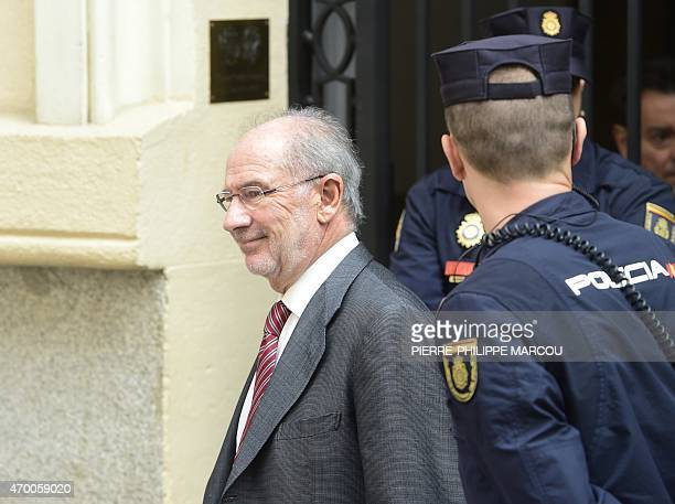 Former IMF head and former Spanish Economy minister Rodrigo Rato smiles as he leaves his office on April 17 2015 in Madrid Spanish tax office agents...