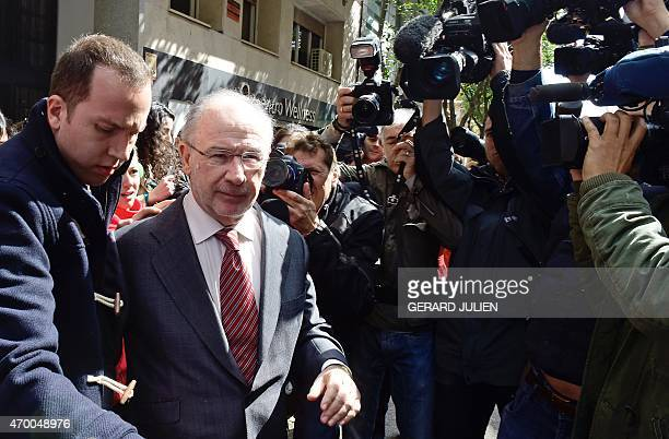 Former IMF head and former Spanish Economy minister Rodrigo Rato is surrounded by the media as he leaves his home on April 17 2015 in Madrid Spanish...