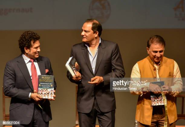 Former indian cricket captain Sachin Tendulkar Mohammad Azharuddin and Sunil Gavaskar during the launch of Rajdeep Sardesai's book at Royal Opera on...