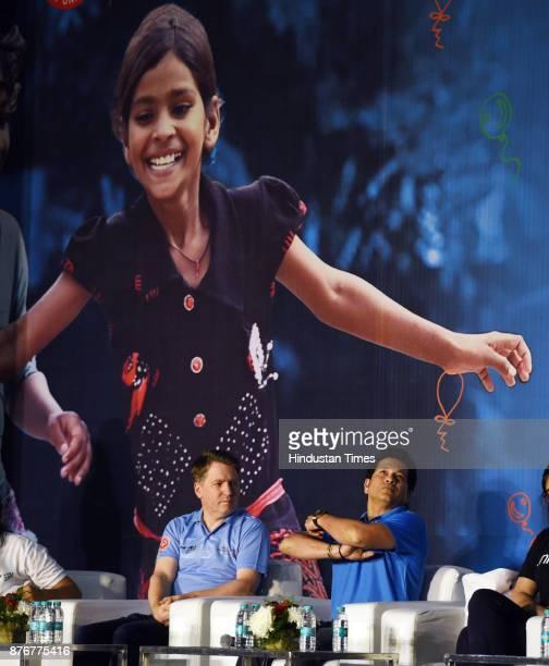 Former Indian Cricket star Sachin Tendulkar interacts with children to celebrate World Children's Day organized by unicef at Thyagraj Stadium on...