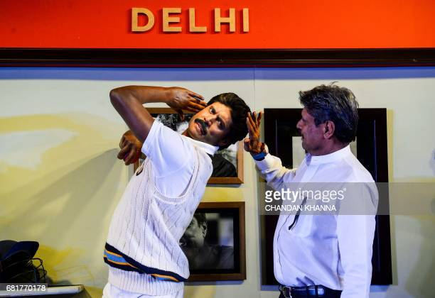 Former Indian cricket team captain Kapil Dev looks on as he unveils his wax figure for the soon to open Madame Tussauds museum in New Delhi on May 11...