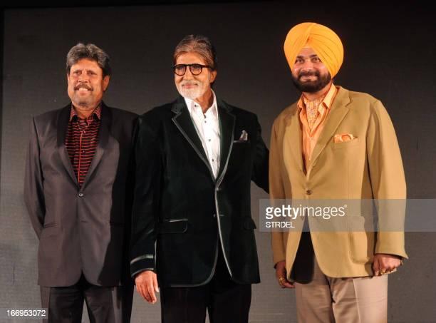 Former Indian cricketer and Bharatiya Janata Party member of parliament Navjot Singh Sidhu poses with Bollywood actor Amitabh Bachchan and former...
