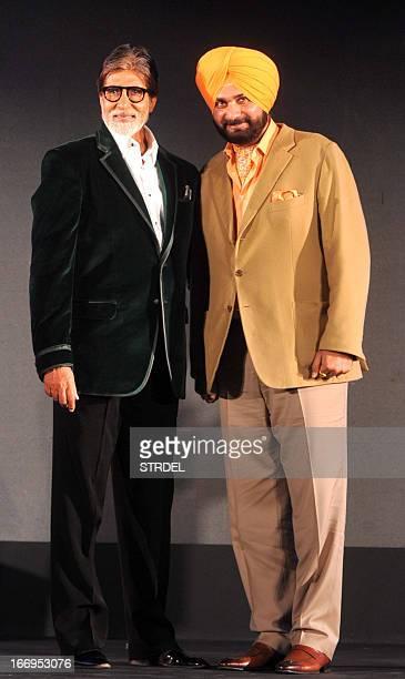 Former Indian cricketer and Bharatiya Janata Party member of parliament Navjot Singh Sidhu poses with Bollywood actor Amitabh Bachchan during a...
