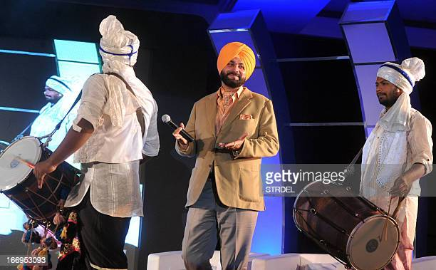 Former Indian cricketer and Bharatiya Janata Party member of parliament Navjot Singh Sidhu poses during a presentation ceremony in Mumbai late April...