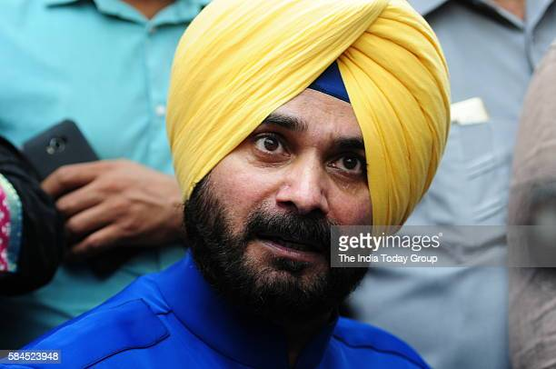 Former Indian cricketer and former member of parliament Navjot Singh Sidhu addresses the media outside his residence in New Delhi