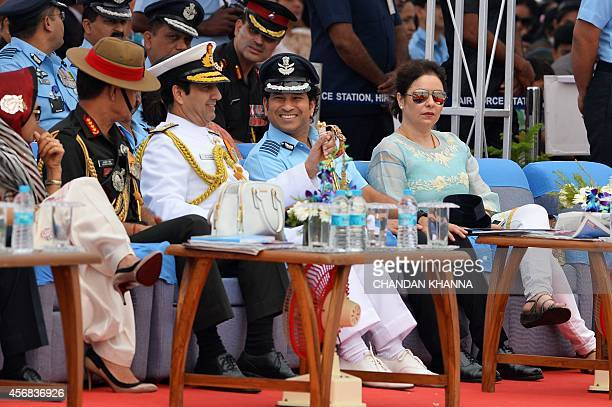 Former Indian cricketer and honorary Indian Air Force Group Captain Sachin Tendulkar shares a light moment with The Chief of the Naval Staff Admiral...